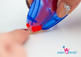 Radiergummestück festkleben