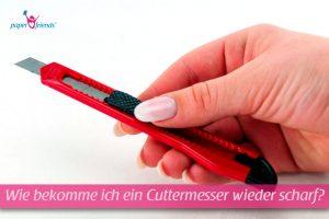 Cuttermesser in der Hand